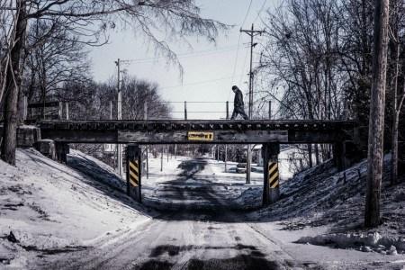 Πίνακας ζωγραφικής Man crossing bridge